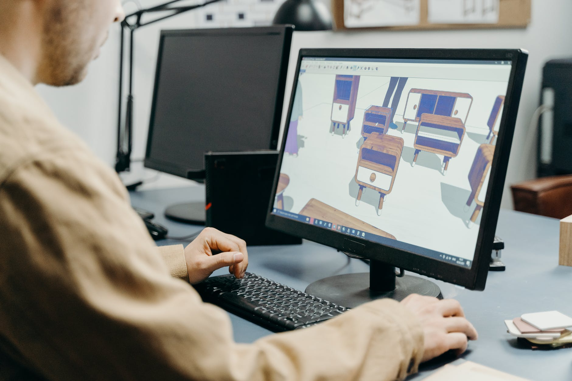 a man using a computer in designing